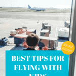 Pinterest image of child looking out airport window at plane