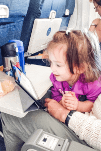 Toddler watching kid-show on plane