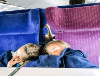 Traveling with kids sleeping on a train.