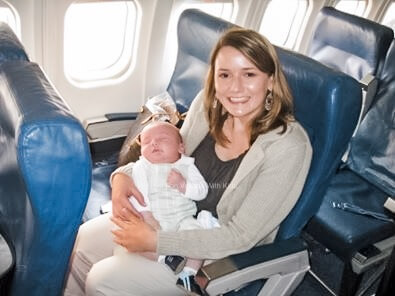 Woman on plane with a baby