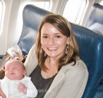 Mom traveling on plane with a baby.
