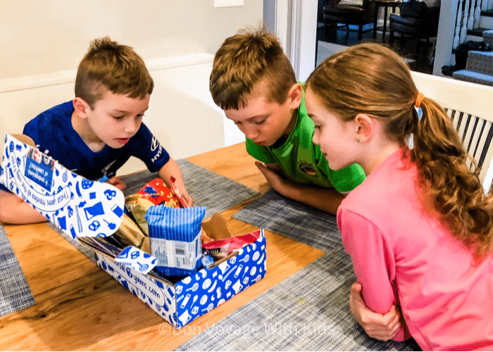best-travel-subscription-boxes-three kids looking