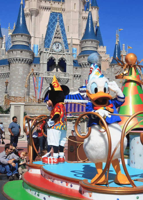 best disney world rides Mickey and Donald in a parade in front of Cinderalla's Castle Magic Kingdom
