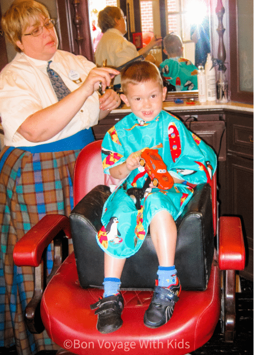 disney with a toddler getting a haircut on main street usa