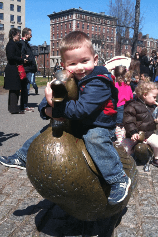 kid on make way for the ducklings statue