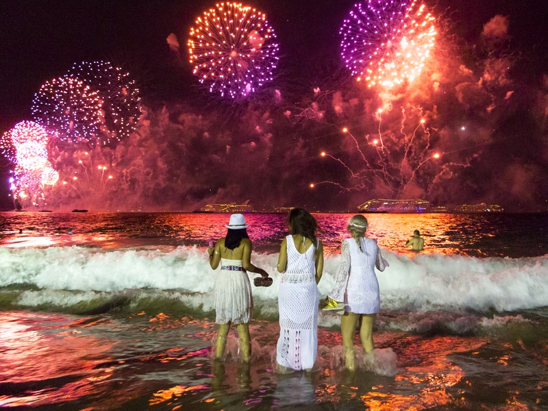 holiday traditions in Brazil jumping waves at new years