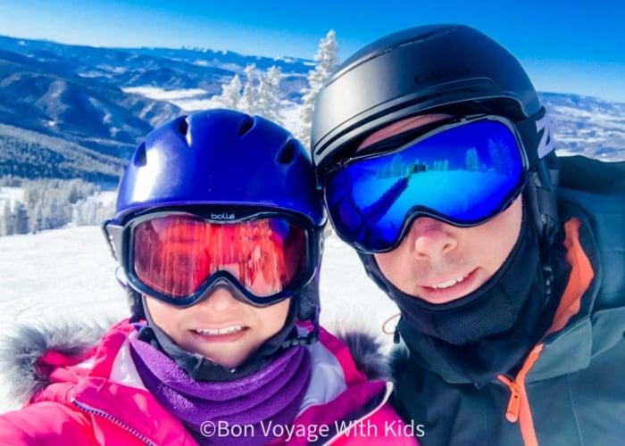 ski-trip-packing-list-couple-posing-shoulder-up