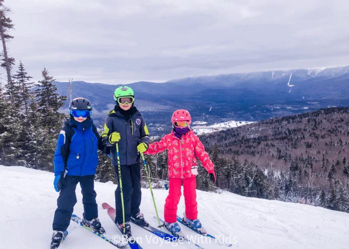 ski-trip-packing-list-kids-on-ski-slope-posing
