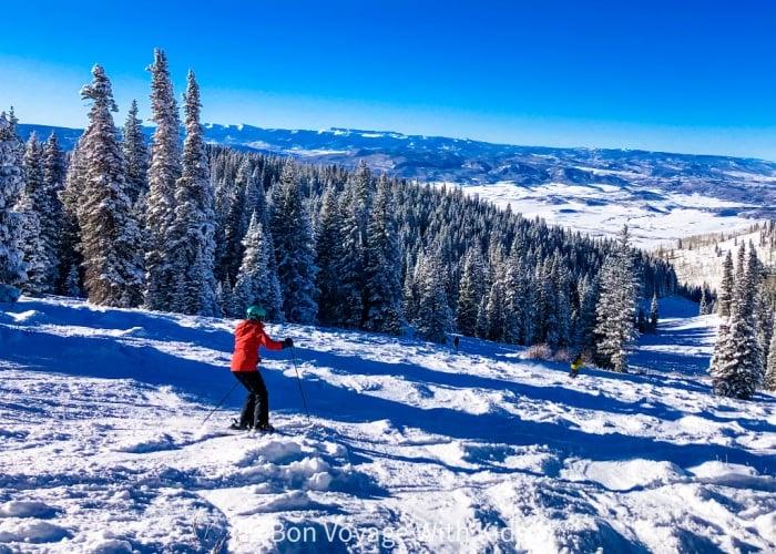 ski-trip-packing-list-person-skiing-down-hill