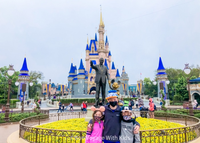 disney-2021-three kids in front of the castle with masks at magic kingdom