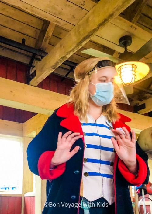 disney 2021 disney cast member wearing mask and face shield