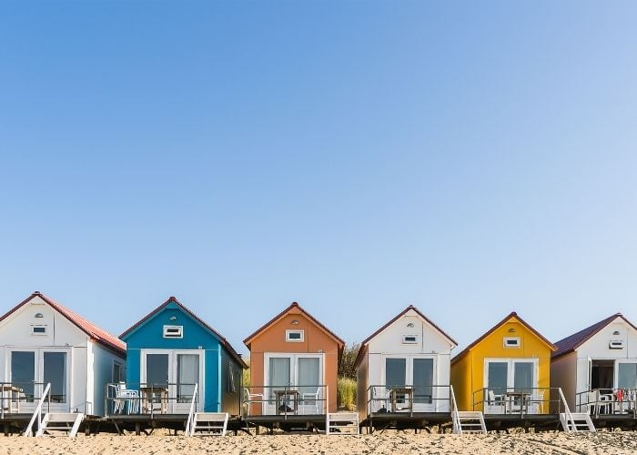 row of colorful beach cottages
