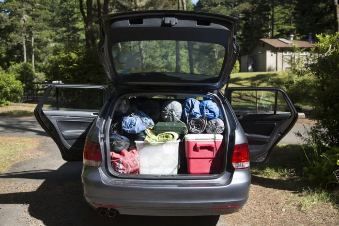 road trip food car filled with camping equipment and cooler