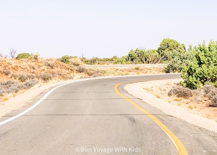 tips for road trips road with now one on it