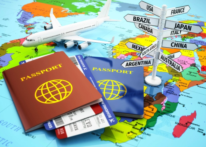 why use a travel agent passports, toy plane, directions on map image