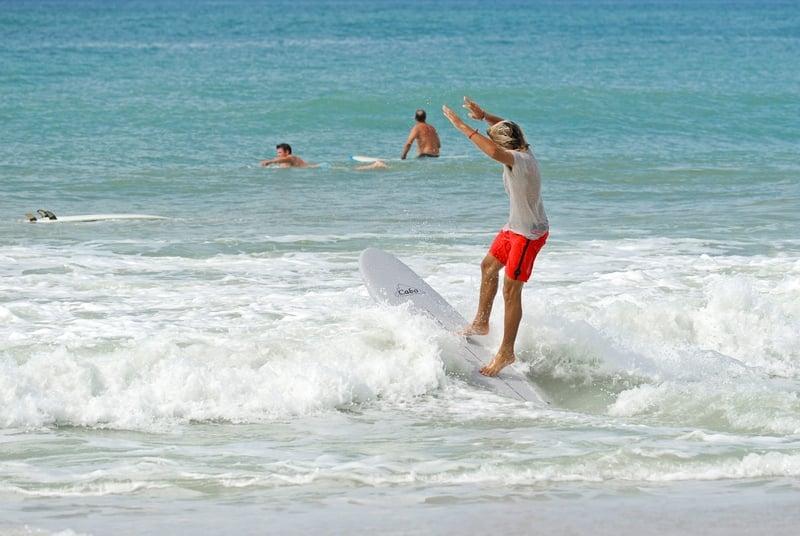 teen surfing on Anna Maria Island