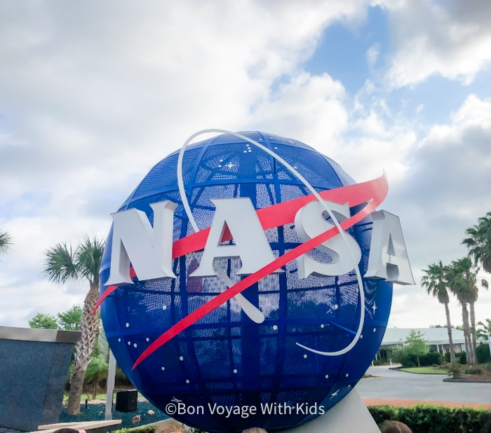 visit kennedy space center nasa sign at entrancce