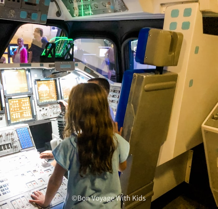 visit kennedy space center kids interactive play area in one of the space capsuls