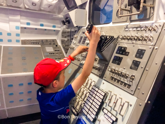 visit kennedy space center kids interactive area in one of the capsuls