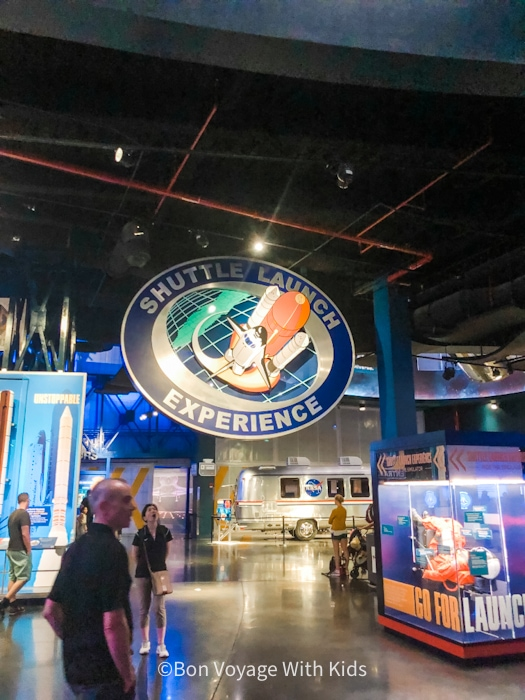 visit kennedy space center shuttle launch experience sign and display area