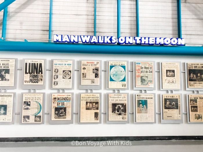 visit kennedy space center man walks on moon display of newspapers