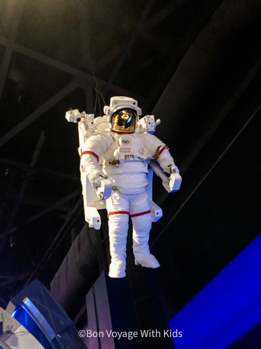 visit kennedy space center astronaut suit hanging in building