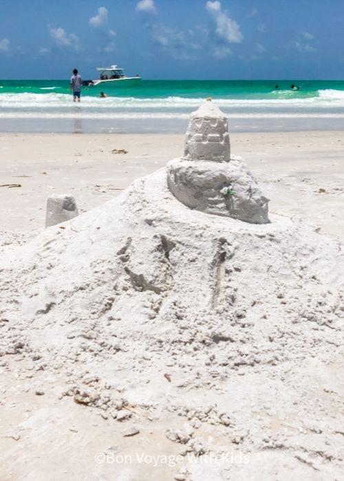 sand caslte on white sand on anna maria island
