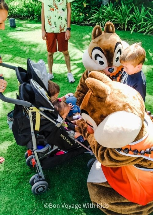 Chip and Dale greeting kids at Disney's Aulani, a Resort and Spa