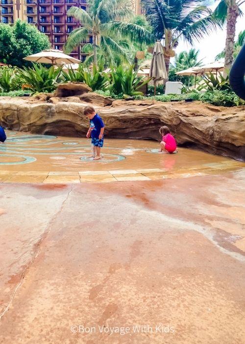 kids splashing in play area at Disney's Aulani