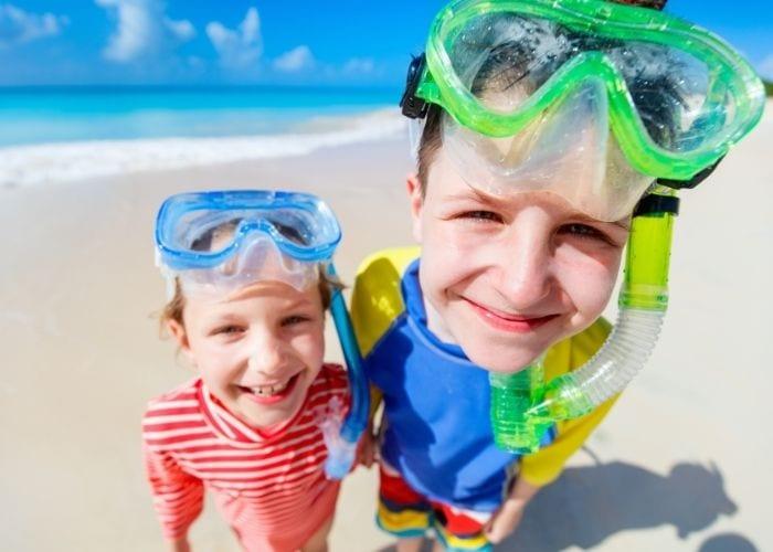 kids wearing snorkel gear for beach packing list family