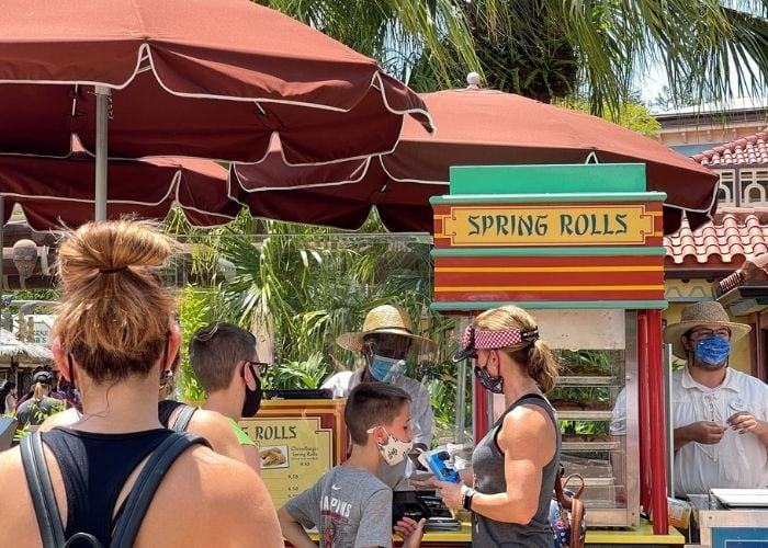 people in line at Disney World for spring roll in Magic Kingdom best snacks at disney world